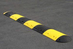Parking lot speed bump installation