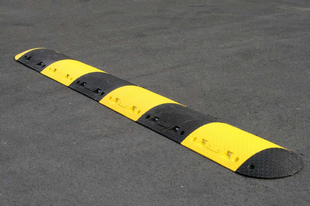 Parking lot speed bump installation