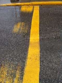 TBL Durables line striping paint on a road