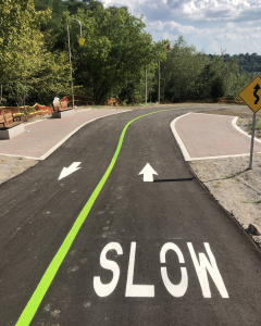 A pathway with directional line painting