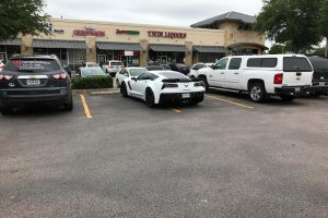 A corvette parked in the middle of two parking spots