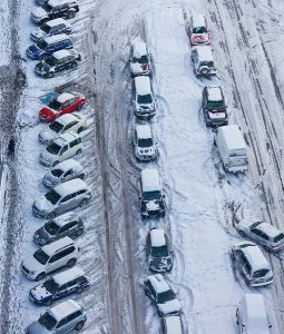A parking lot covered in snow
